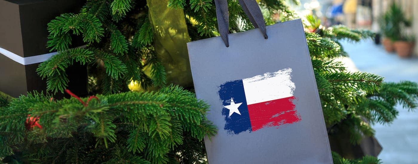 The flag of Texas is on a gift bag hanging from a Christmas tree in Waxahachie, TX.