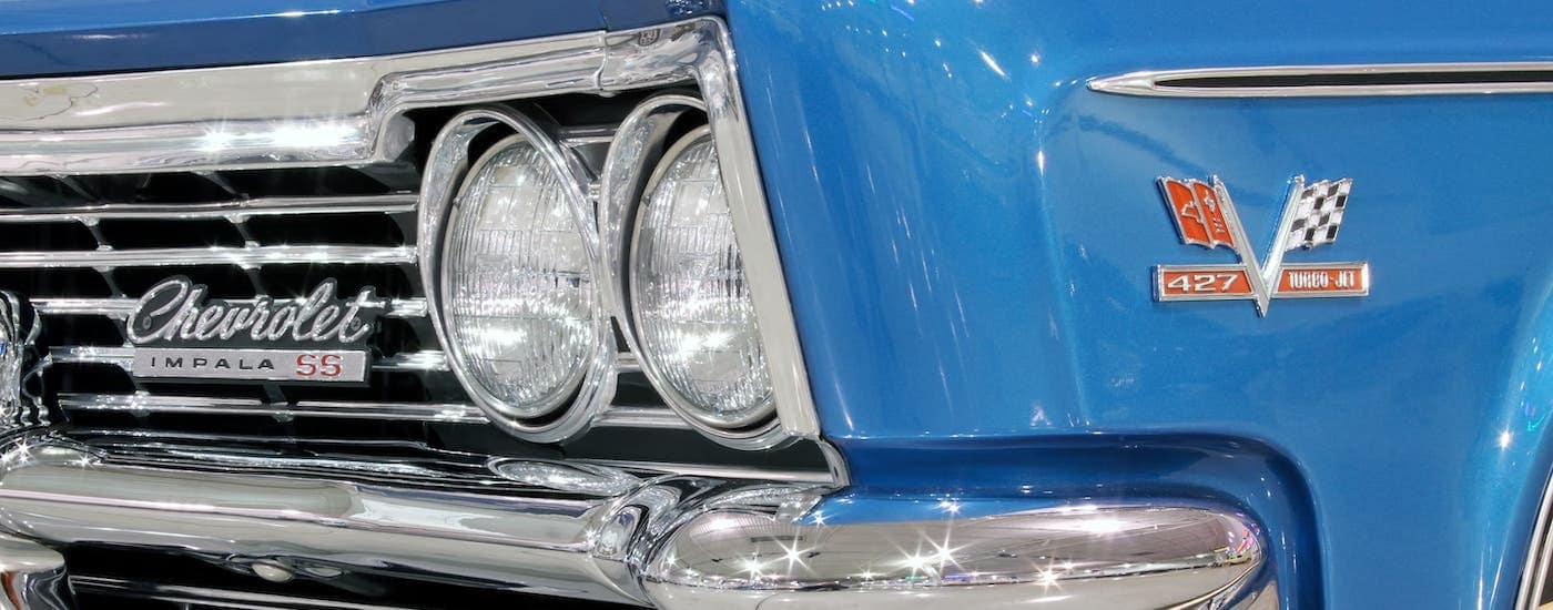 A closeup shows the grille of a blue 1966 Chevy Impala SS, a rare find at a Chevy dealership in Fort Worth, TX.