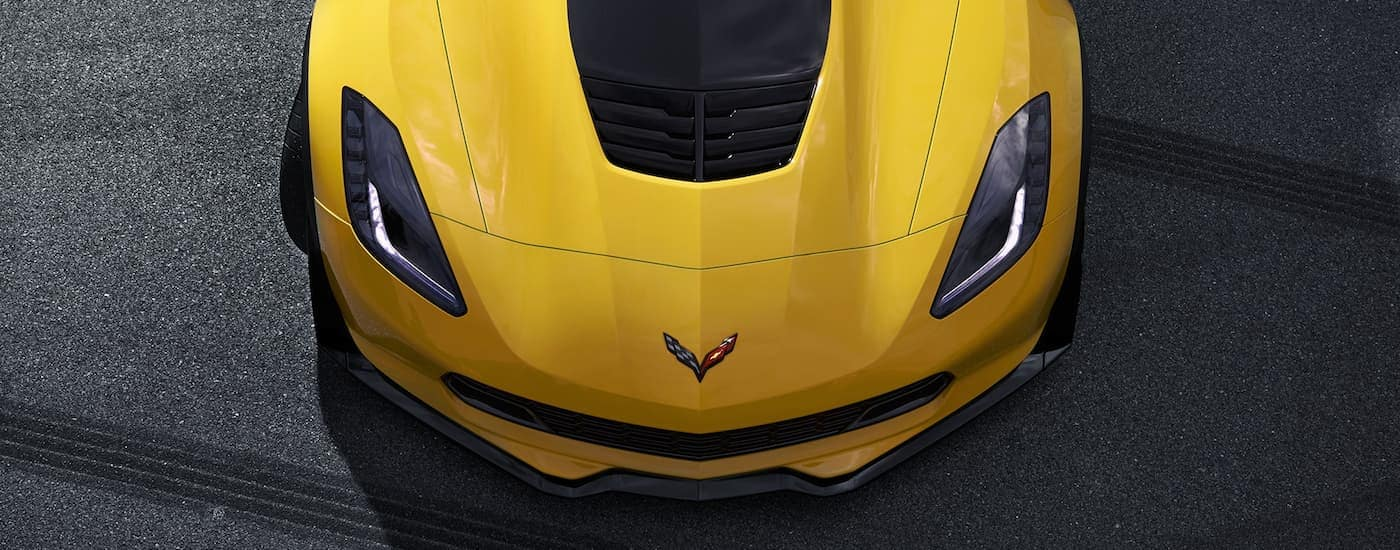 A look down on a yellow 2019 Chevy Corvette Z06 at a Chevy dealer near me.