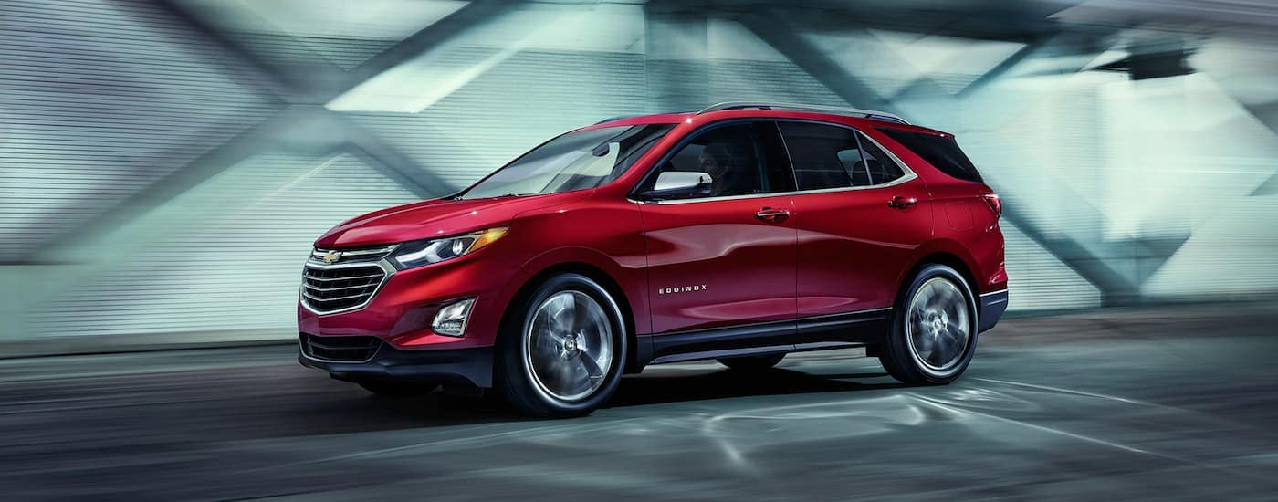 Of the Chevy SUVs a red 2019 Chevy Equinox drives off in a tunnel.
