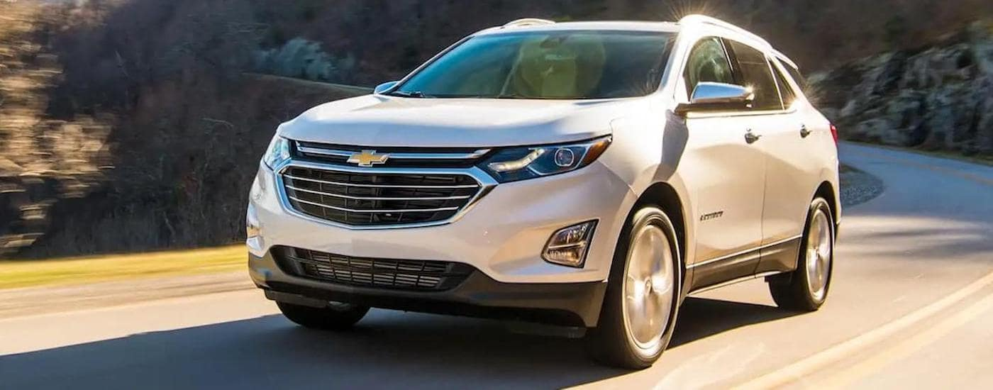 A silver 220 Chevy Equinox on a test drive from a local Chevy dealer near you.