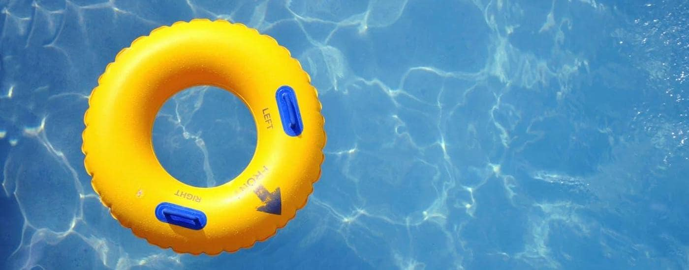 A top-down view is shown of a yellow inner tube floating in a pool at a waterpark near Waxahachie.