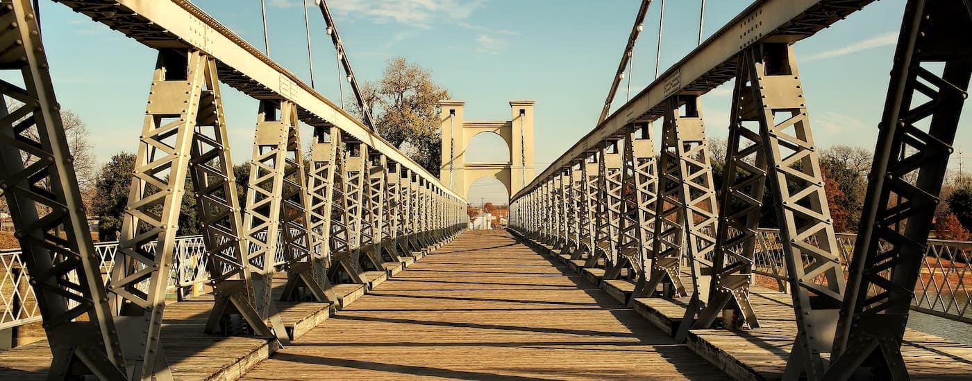 A walkway over a suspension bridge is shown in Waco, a short drive from your new favorite Chevy dealership near Waco, Frank Kent Country.