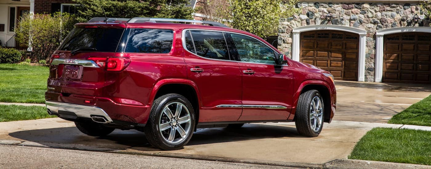 GMC Acadia Denali in front of Fort Worth house