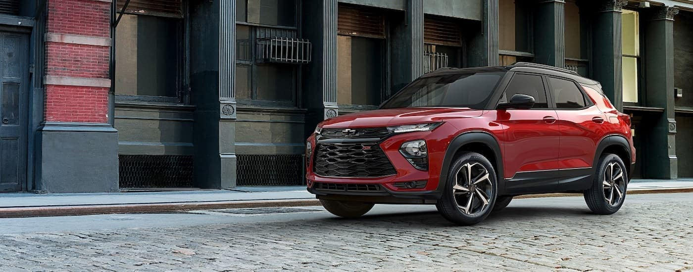 A red 2021 Chevy Trailblazer, not yet available from your local Chevy dealership, is on a cobble street near Corsicana, TX.