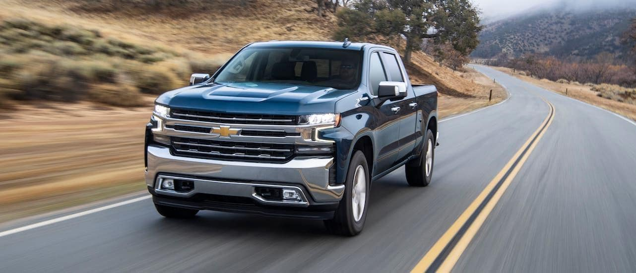 A blue 2020 Chevy Silverado is driving on a highway outside Corsicana, TX.