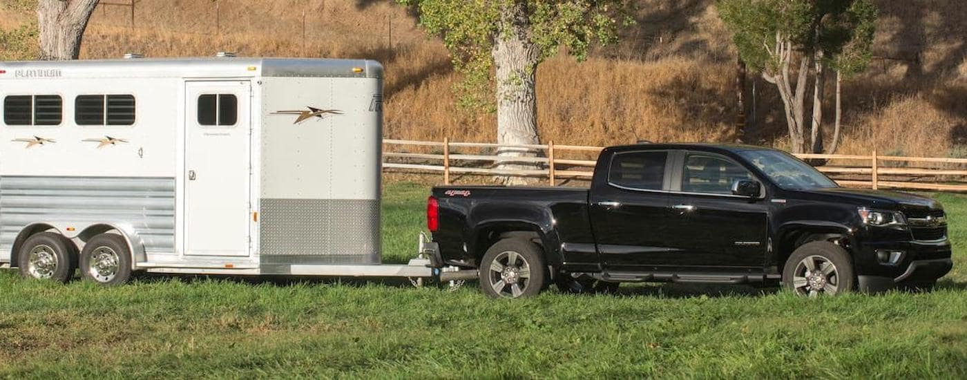A black 2018 Chevy Colorado, one of the popular Chevy trucks, is towing a horse trailer near Corsicana, TX.