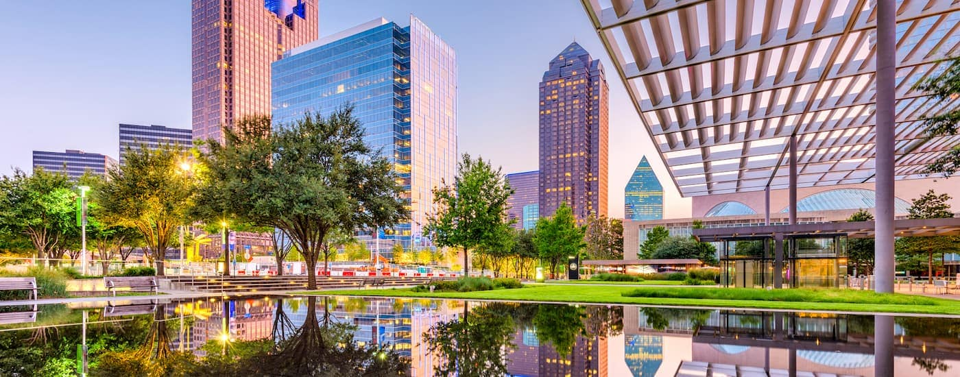 A view of Dallas, TX from a park is shown. Check out this blog for a list of non-Chevy, Dallas local attractions.
