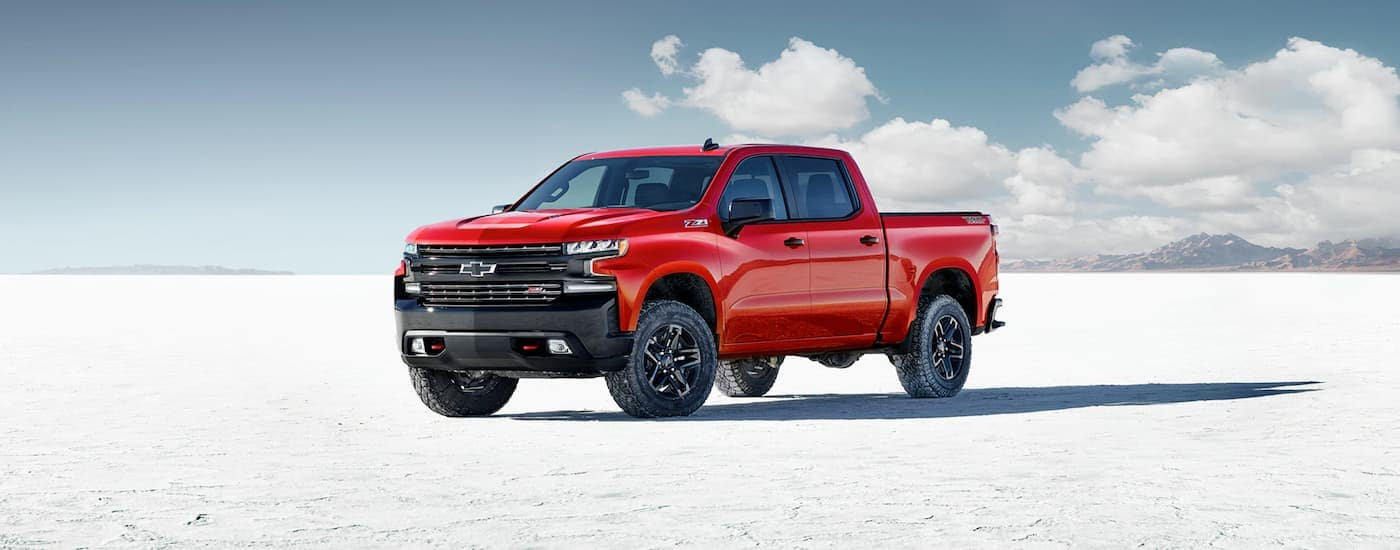A red 2020 Chevy Silverado Trail Boss, popular at our Chevy dealership in Corsicana, TX, is parked on a salt flat.