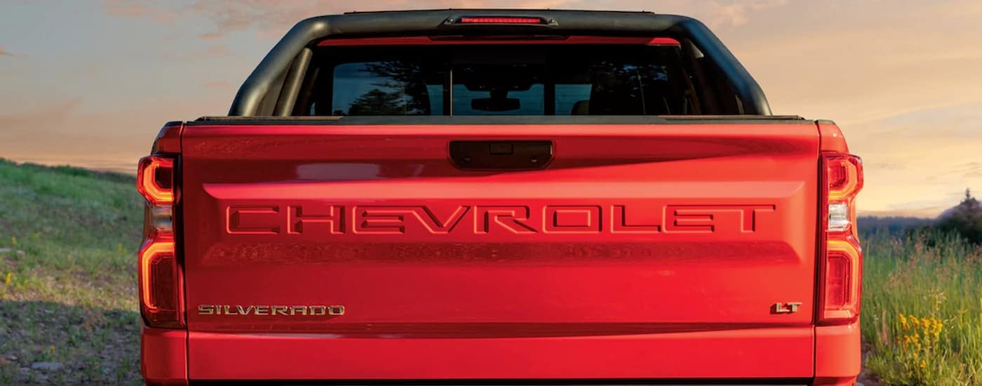 A close up of the tailgate of a red 2019 Chevy Silverado, which can be found at your Corsicana, TX Chevy dealership, is shown.