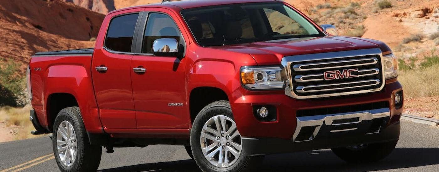 A red 2020 GMC Canyon is angled right on a highway outside Corsicana, TX.