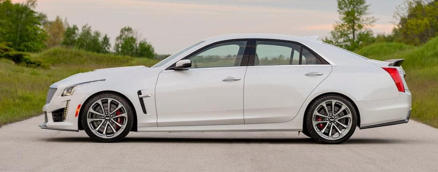 A white 2016 Cadillac CTS-V, popular among used cars near me, is parked side ways on a road near Waco, TX.