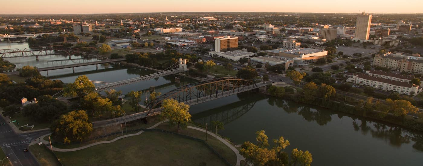 An aerial view of Waco, TX is shown just before sunset.