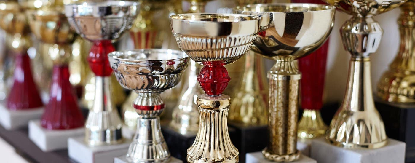 ultiple trophies are sitting on a table at a hall of fame in Waco, TX.