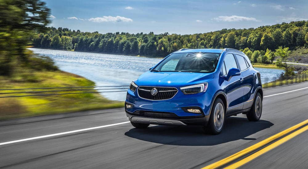 Blue Buick Encore Driving Past a Lake