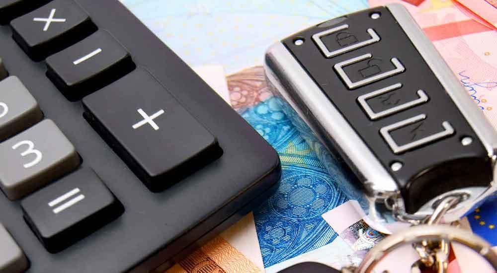 calculator and car keys on a table