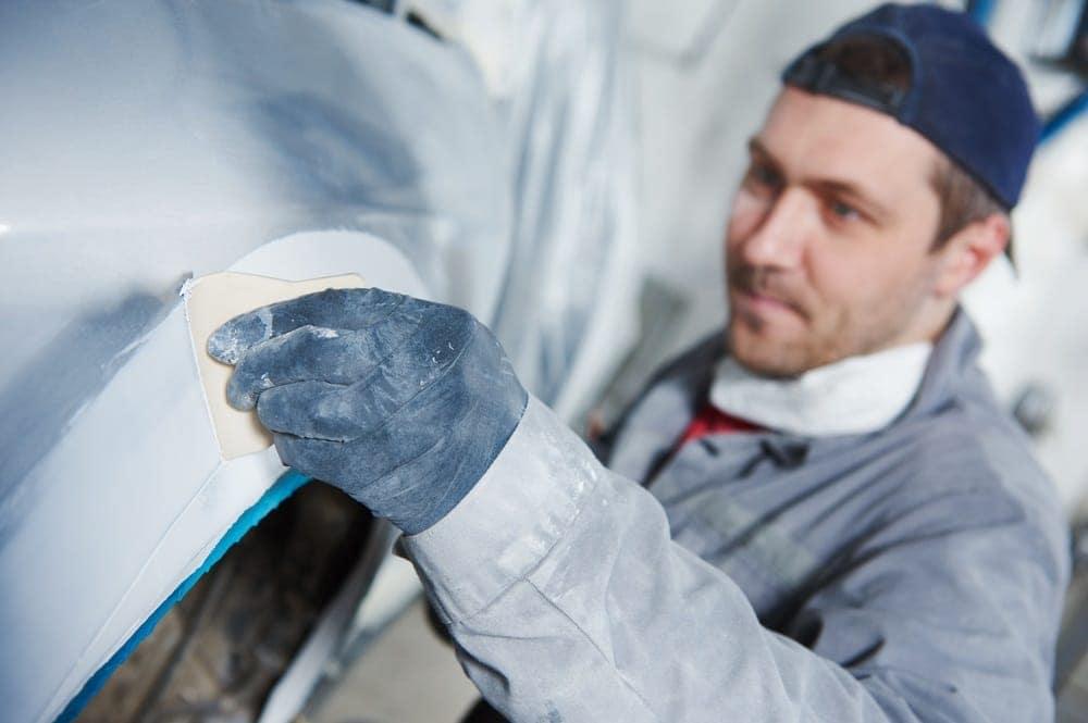 Mechanic detailing a car