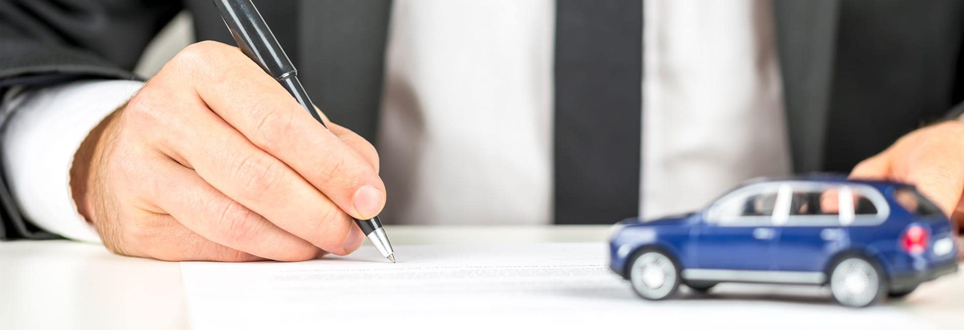 Salesman signing a document