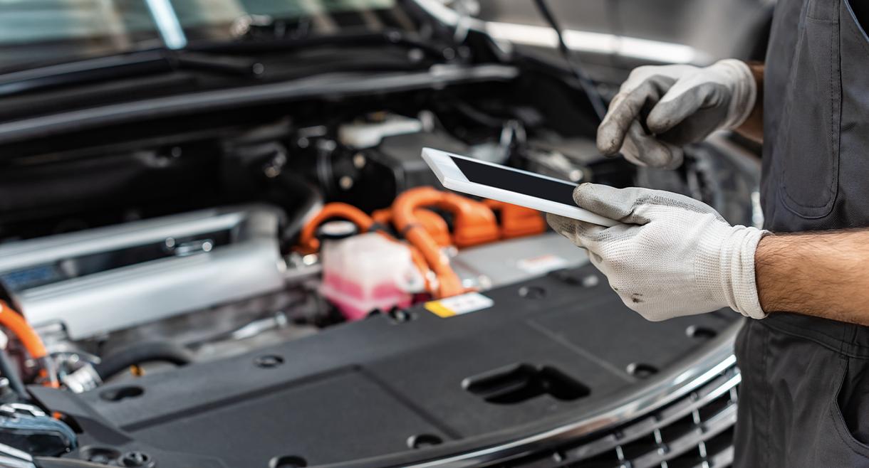 technician goes through checklist on ipad