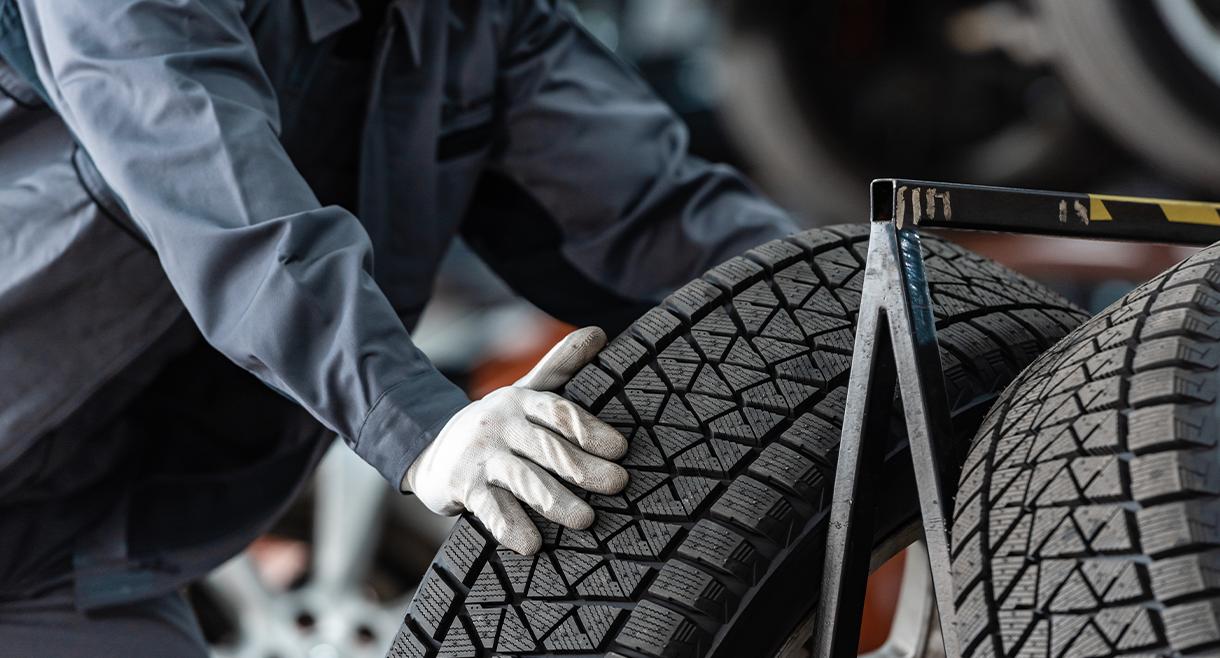 technician installs new tire
