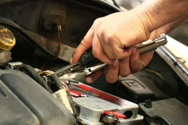 hands repairing a battery