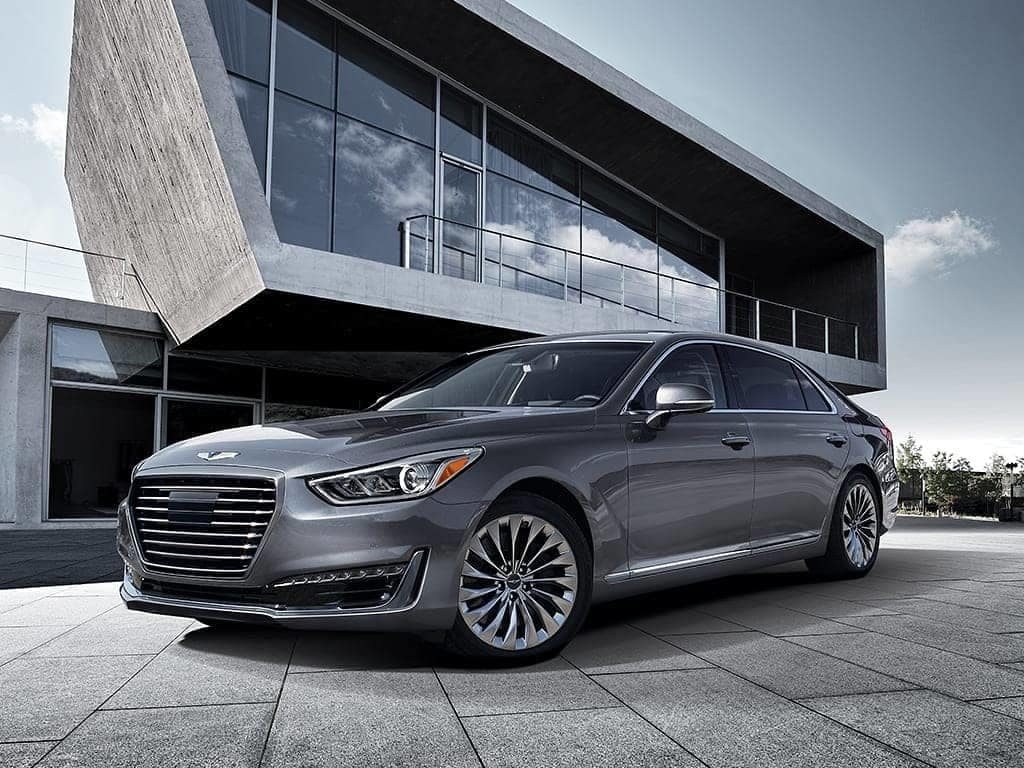 G90 parked in front of modern house