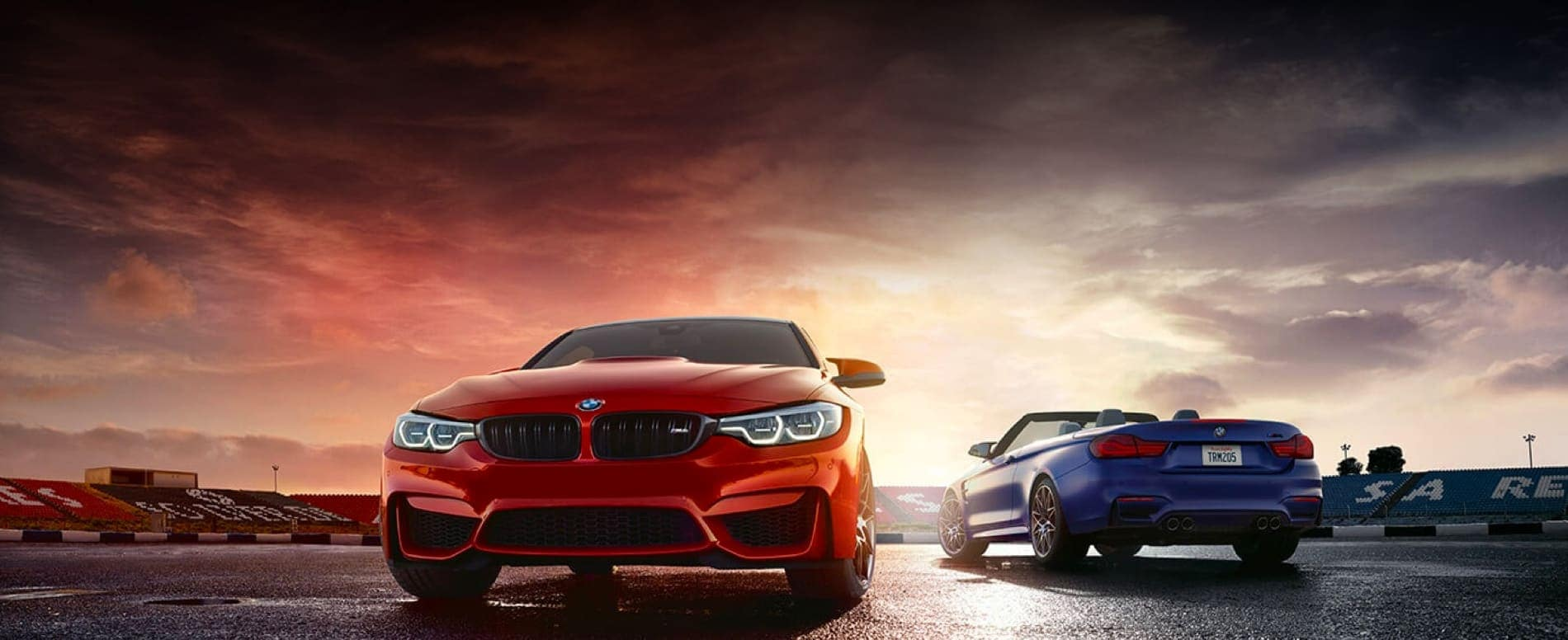 Two BMW vehicles against a backdrop of a sunset