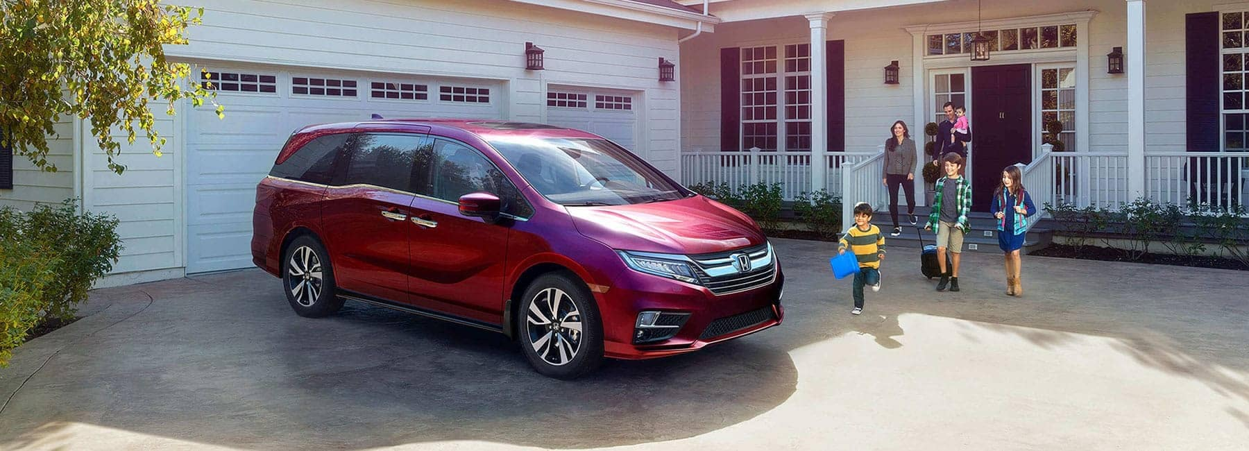 family getting ready to ride Honda Odyssey