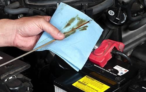 technician wiping dipstick