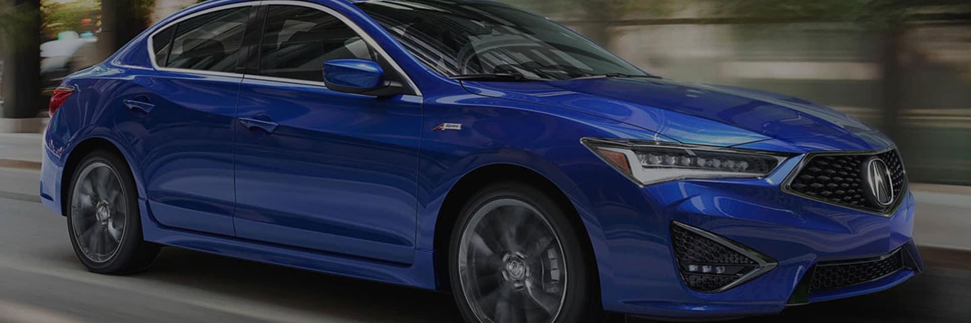 Blue sedan driving down a road