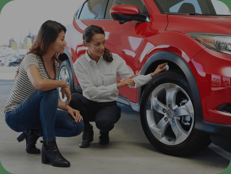 Honda Service Technician gauging tire pressure- service cta image