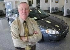 interior image of car salesman in showroom at Gold Rush Chevy