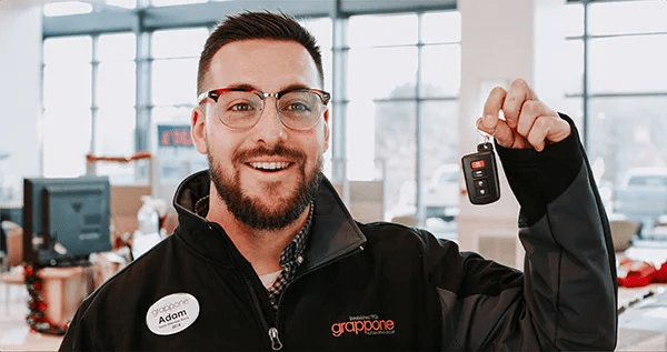 grappone employee holding keys for test drive