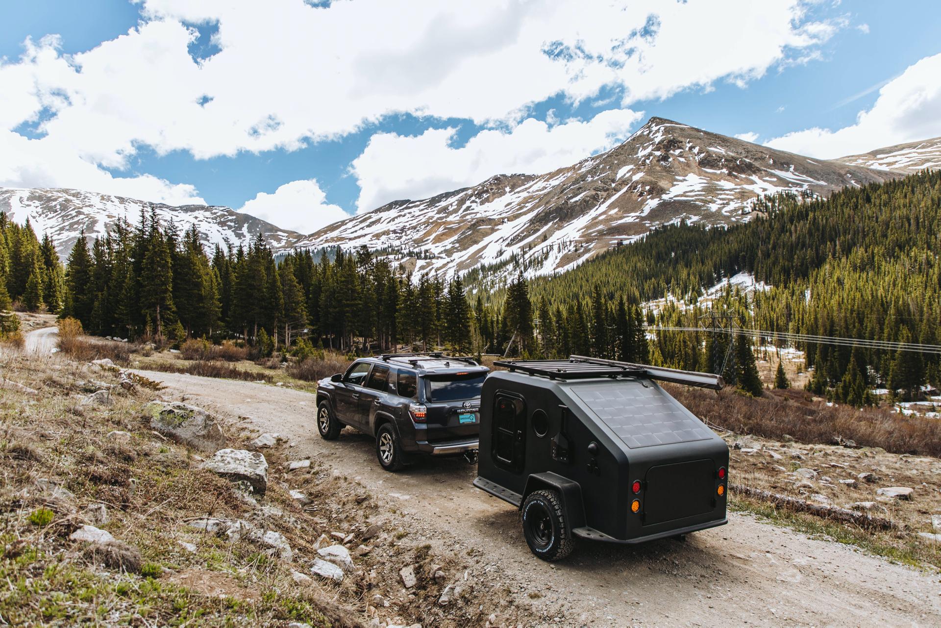 4runner-pulls-trailer-up-mountain-road
