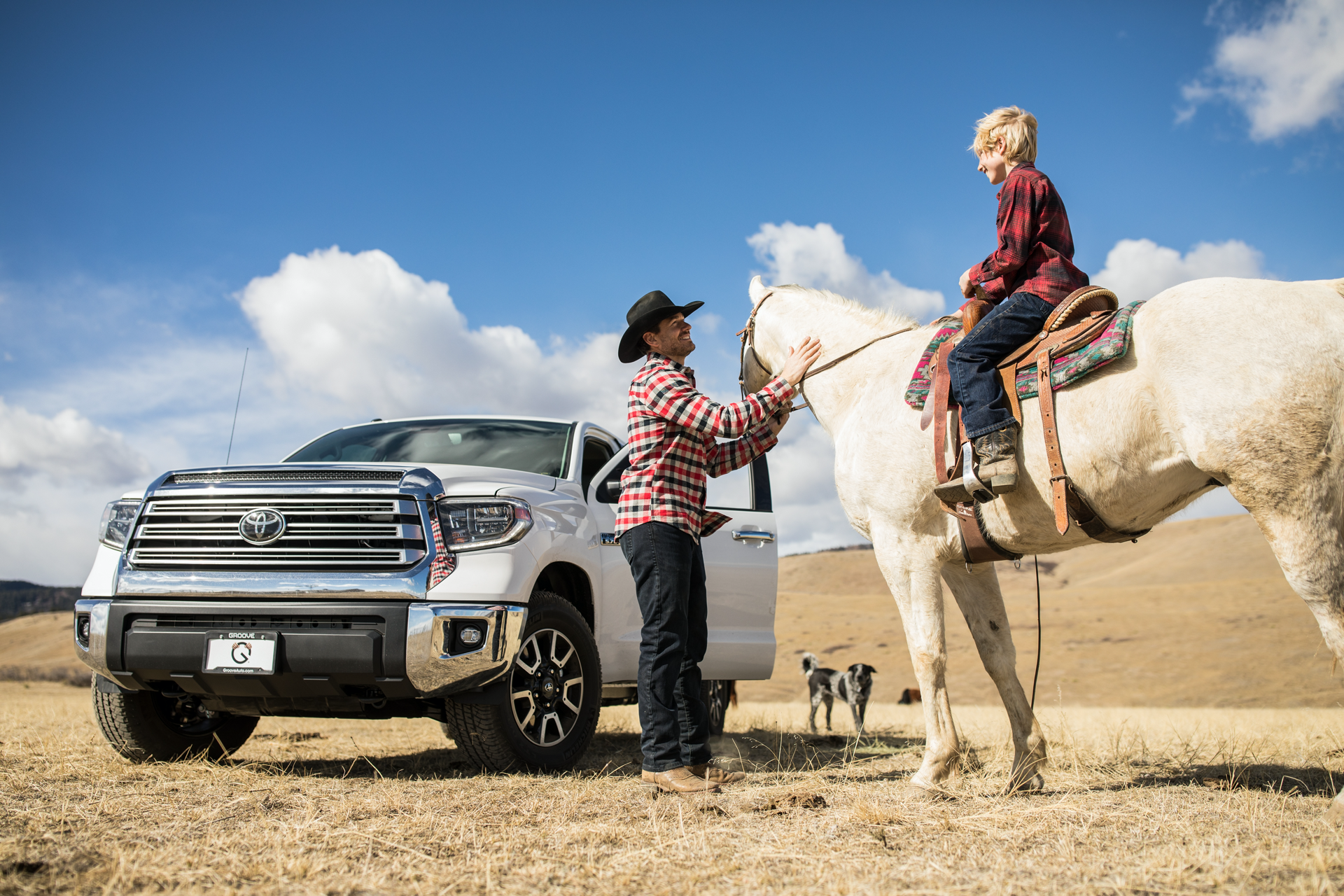 Groove-Toyota-truck-parked-next-to-man-and-child-on-horseback