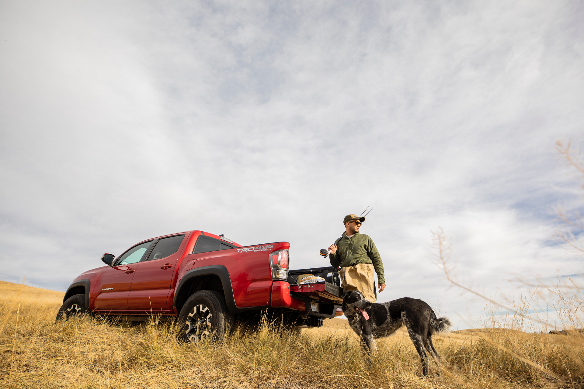 hunting-man-and-dog-next-to-Toyota-truck