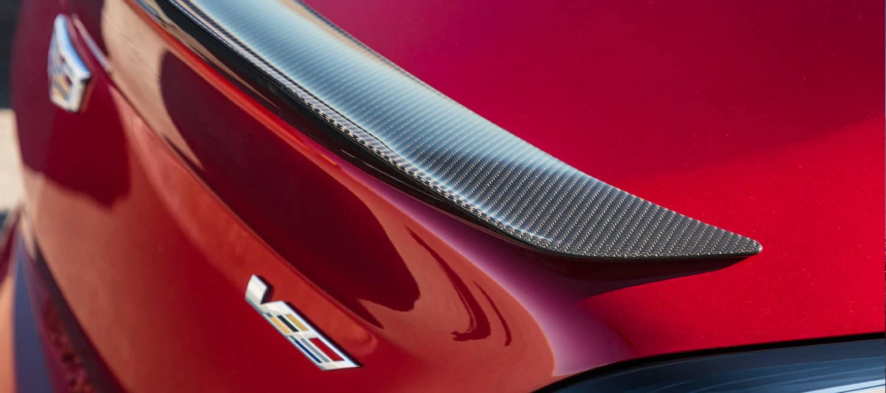 An exterior shot of a Cadillac rear fender red