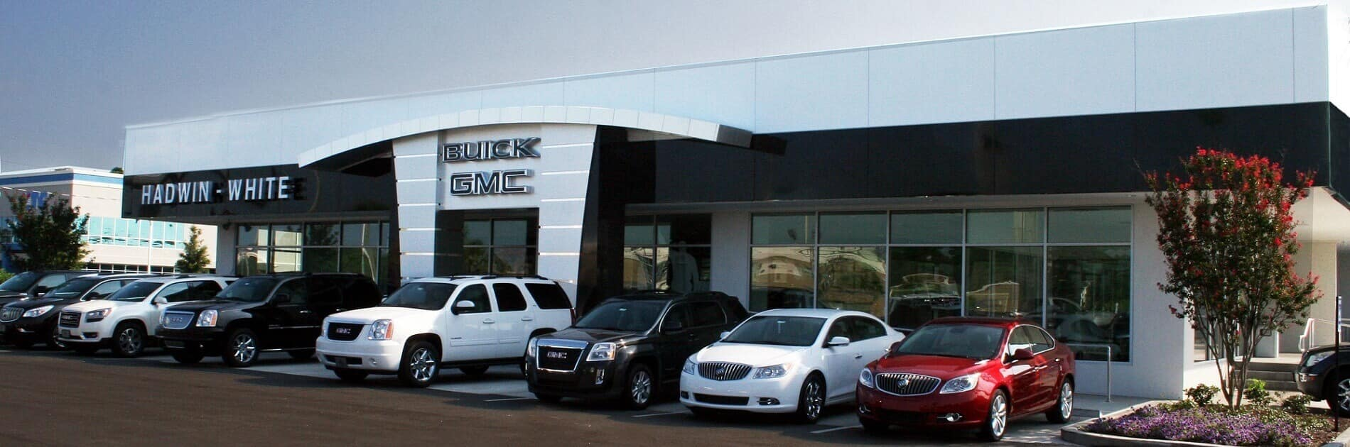 An exterior shot of a Buick GMC dealership building.