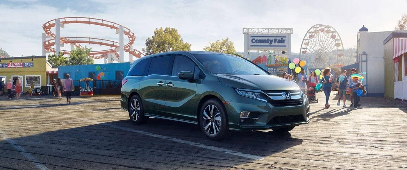 2018 Honda Odyssey parked outside amusement park