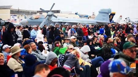 people gathering in front of a plane