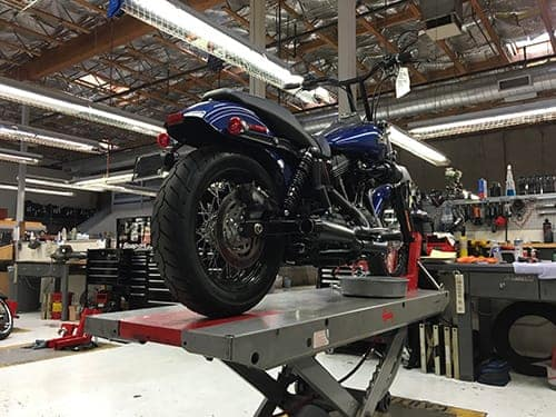 A Harley up on a service lift