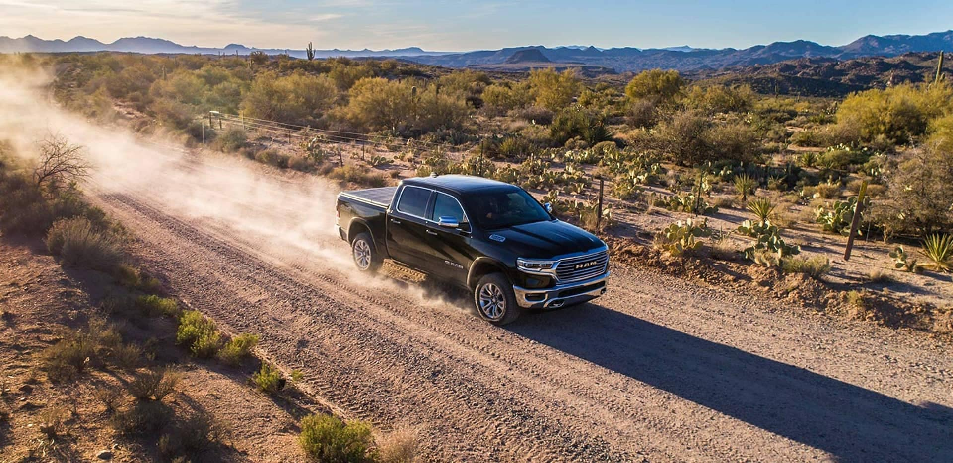 2019 Ram driving in the field Exterior