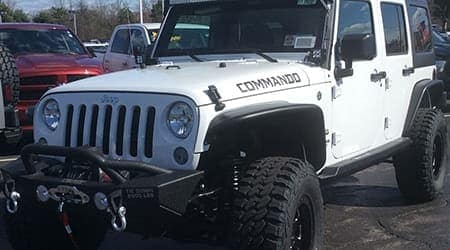 Custom Jeep Commando white outdoors