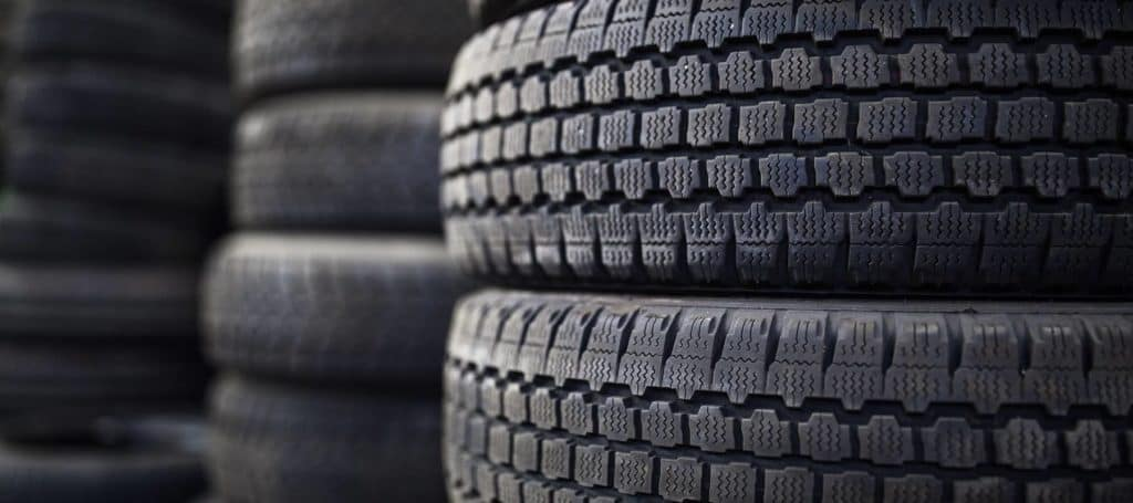 stacks of black car tires
