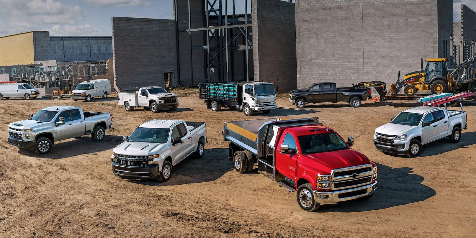 2021 commercial chevy trucks parked at construction site