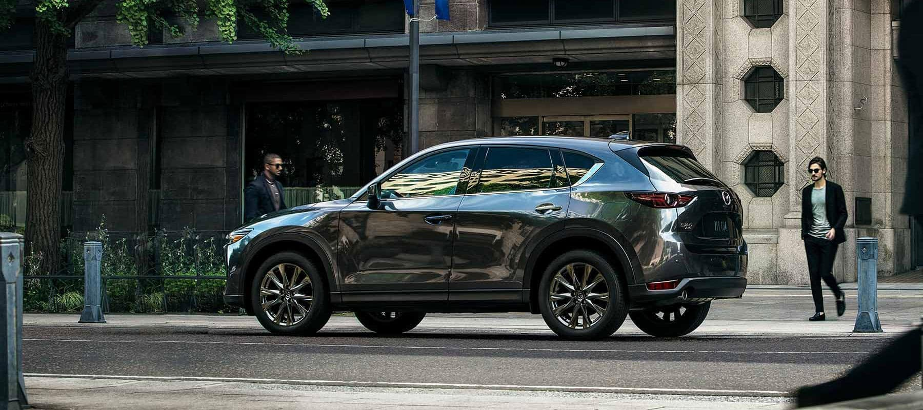 Mazda CX-5 parked on the side of the road in a city