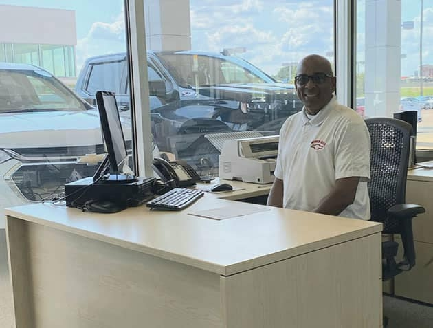 A Herrin-Gear Finance Manager at his desk, ready to help a customer.