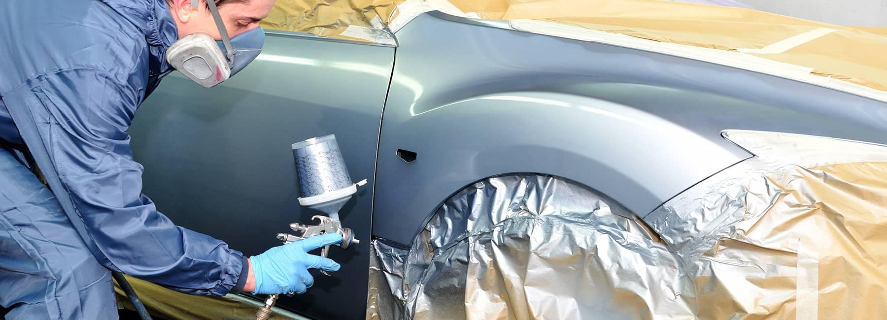 technician spraying car body
