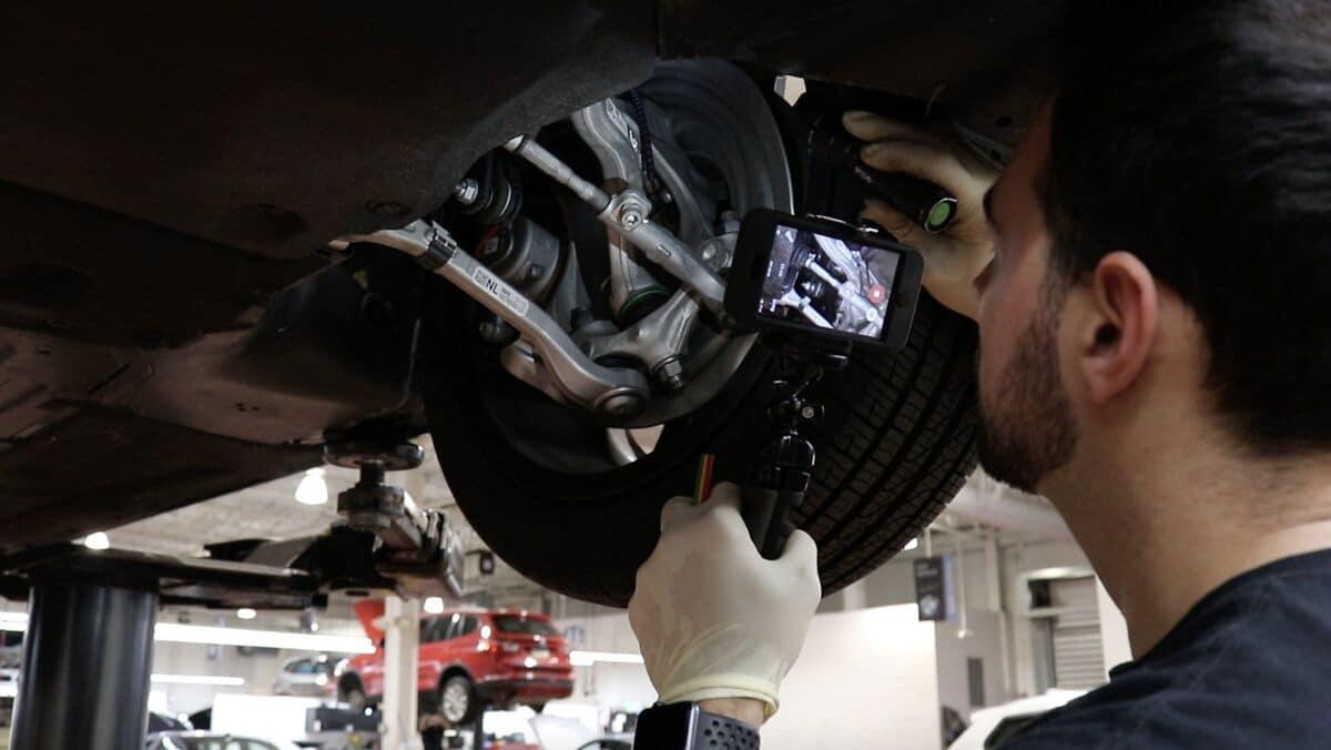 service technician repairs car