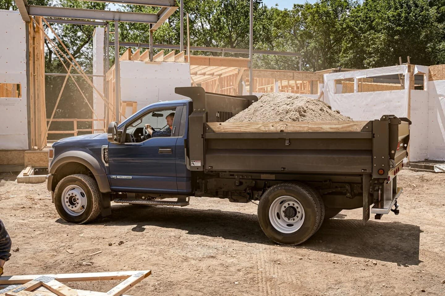 Ford dump truck carrying load of dirt